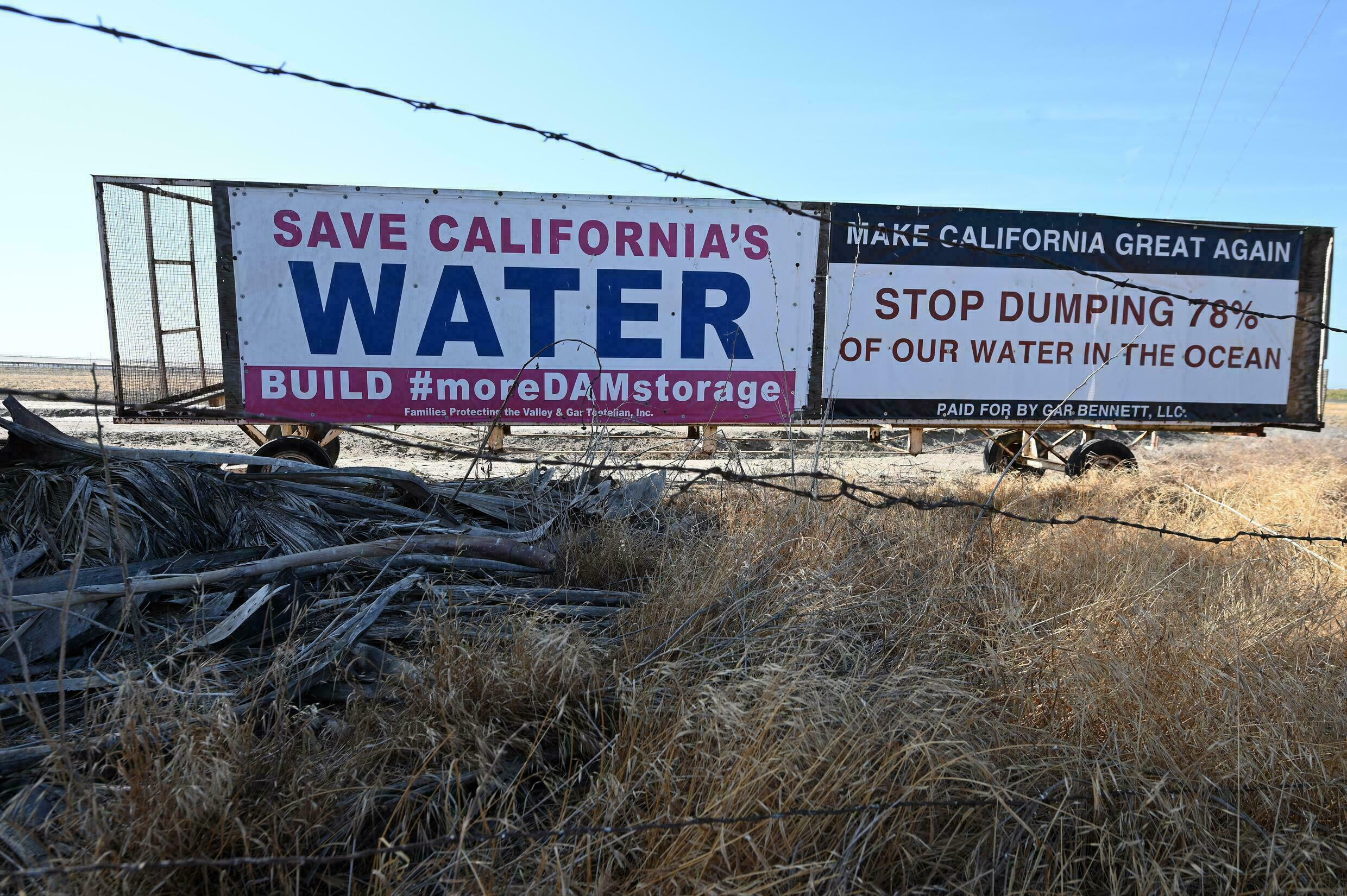 Billboards like these have popped up in farming areas of central California amid political battles over precious water supplies