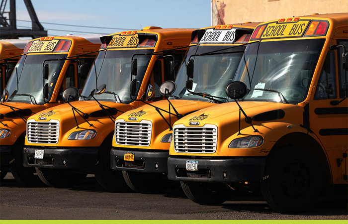 School buses are parked at a bus depot in the Red Hook neighborhood of Brooklyn.